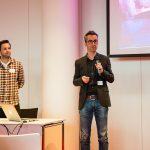 """Dominik Zerr und Michael Wörmann von der Facit Group während ihres Vortrags """"How to: UX-Labortests von Voice User Interfaces"""""""
